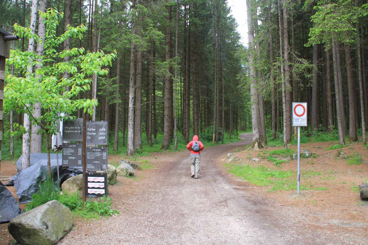 Julie going past some cafe and onto the trail for Cascate di Riva or Reinbachfalle