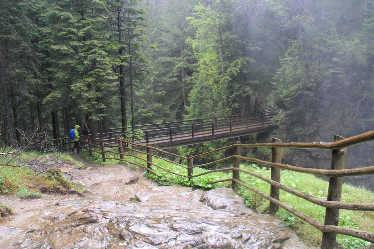 At the very misty third waterfall looking back towards the footbridge crossing the gorge caused by the Riva