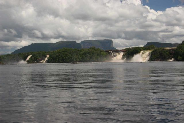 Canaima_077_11202007 - Prior to walking to Salto El Sapo, we had to boat across the lagoon from Canaima, where we got this beautiful view of many waterfalls fronting tepuys in the background