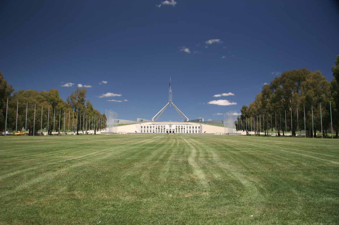 On a very large lawn area looking towards the Parliament Building in Canberra