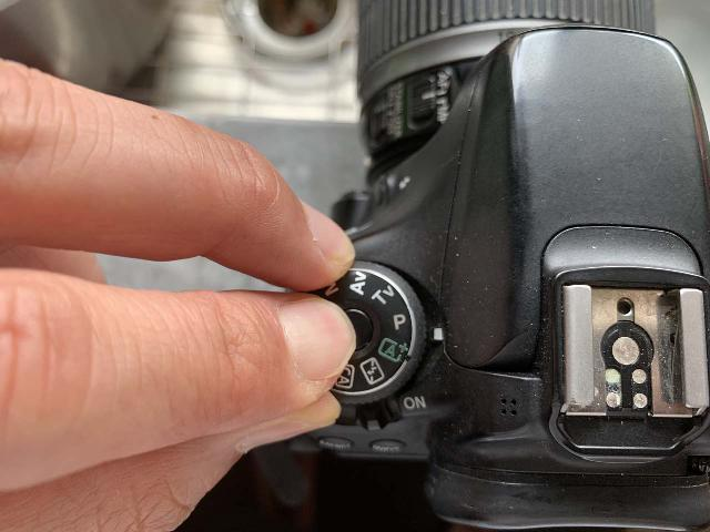 Turning the mode dial to 'P' on my DSLR camera