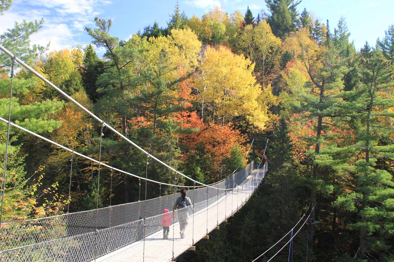 Julie and Tahia crossing the suspension bridge across Canyon Sainte-Anne
