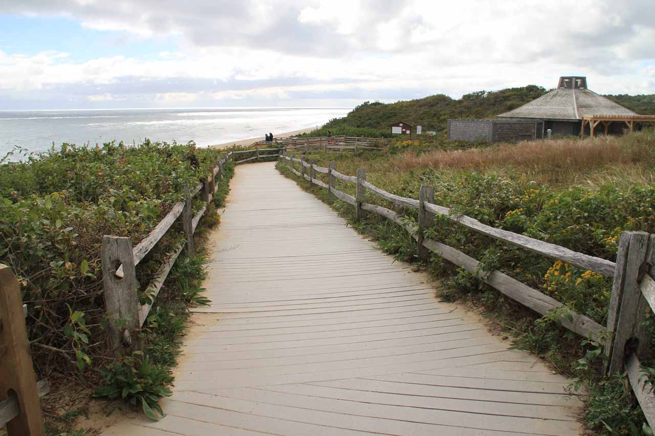 The boardwalk with overviews of the beach beneath Nauset Light