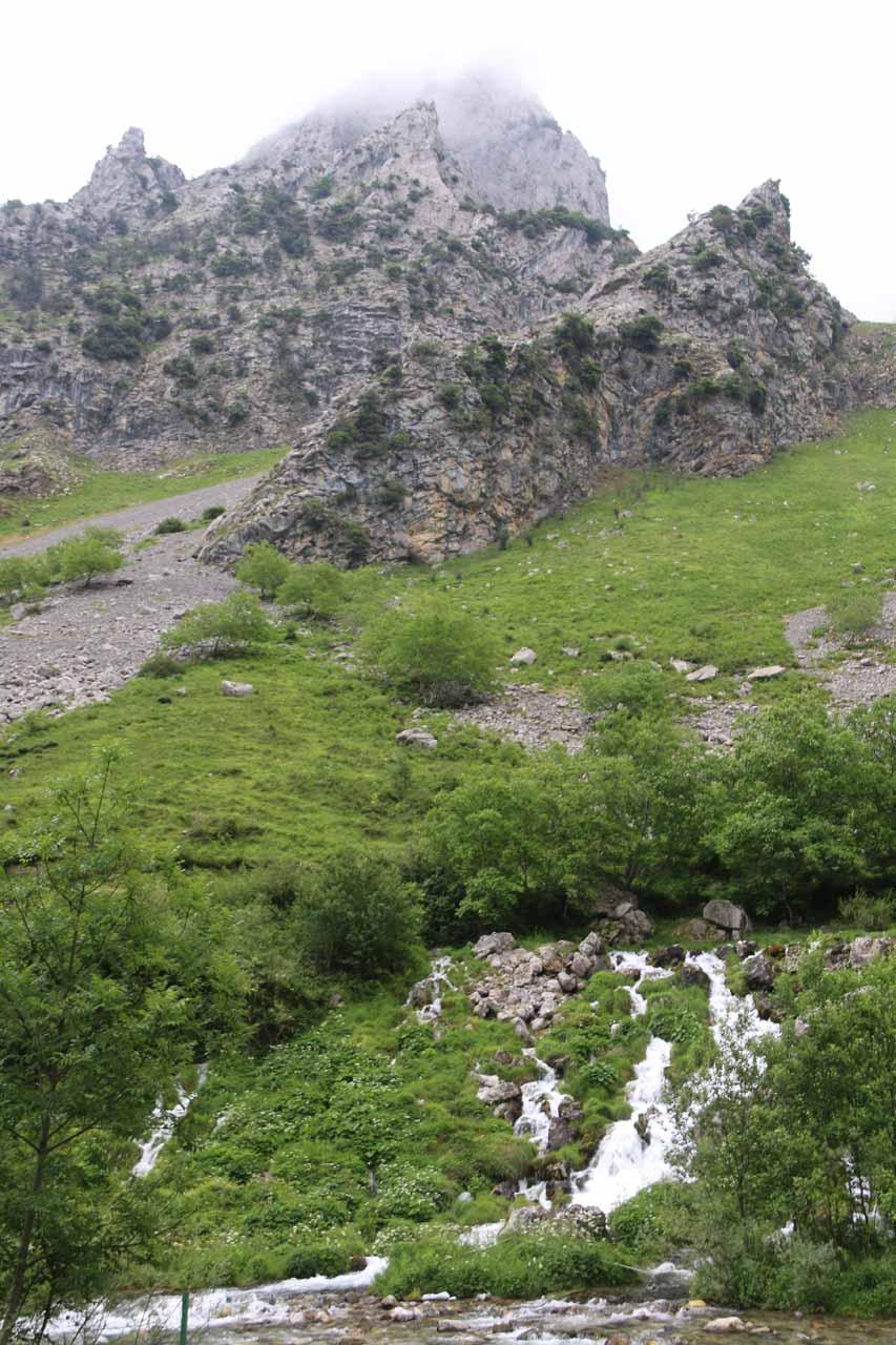 Looking towards a cascade beneath some impressive tall and jagged mountains near Cain de Valdeon