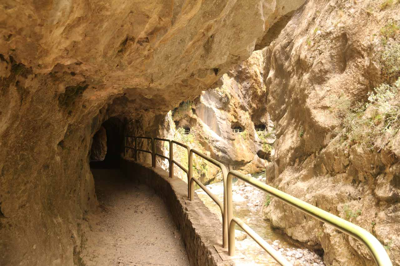 Walking through impressive tunnels along the Cares Gorge hike
