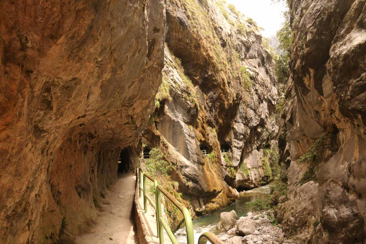 Walking deep inside the Cares Gorge through ledges and attractive tunnels