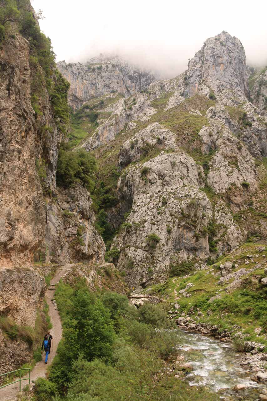 Context of the narrow Cares Gorge hike with the river and tall mountains surrounding the scene
