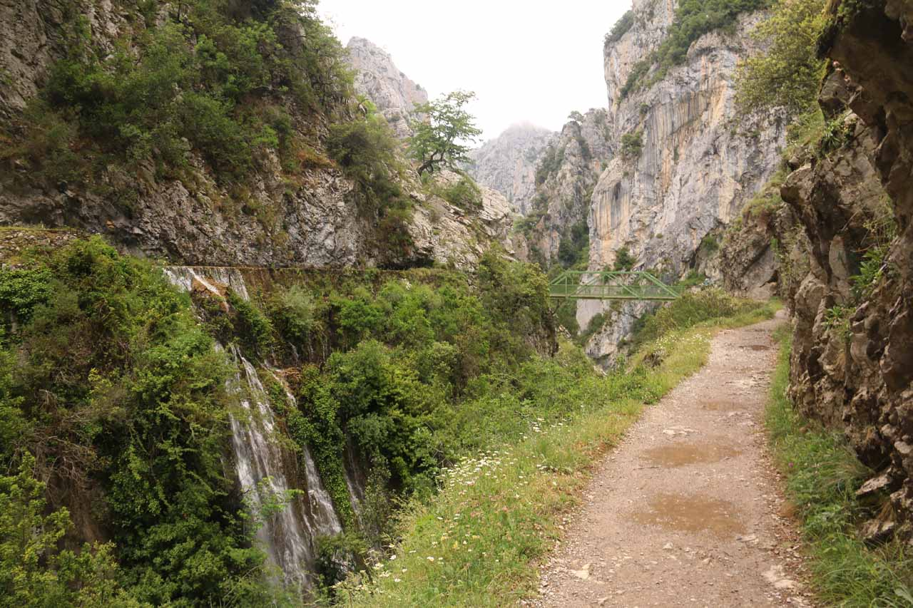 On the cliff-hugging Ruta de Cares where a waterfall from the overflowing banks of a canal flowed across from me
