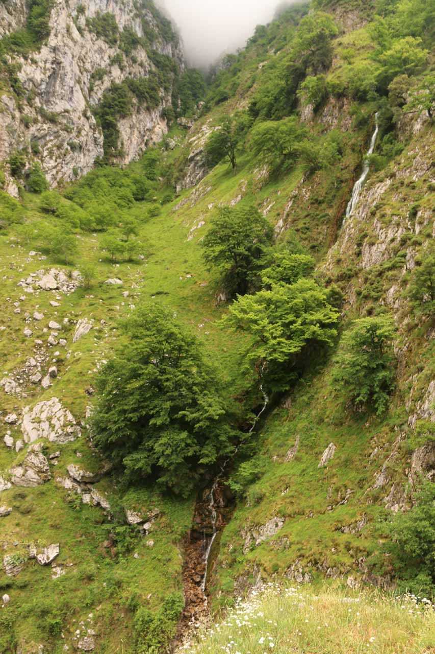 Looking down at one of the few attractive natural waterfalls within the Cares Gorge near the Puente Bolin