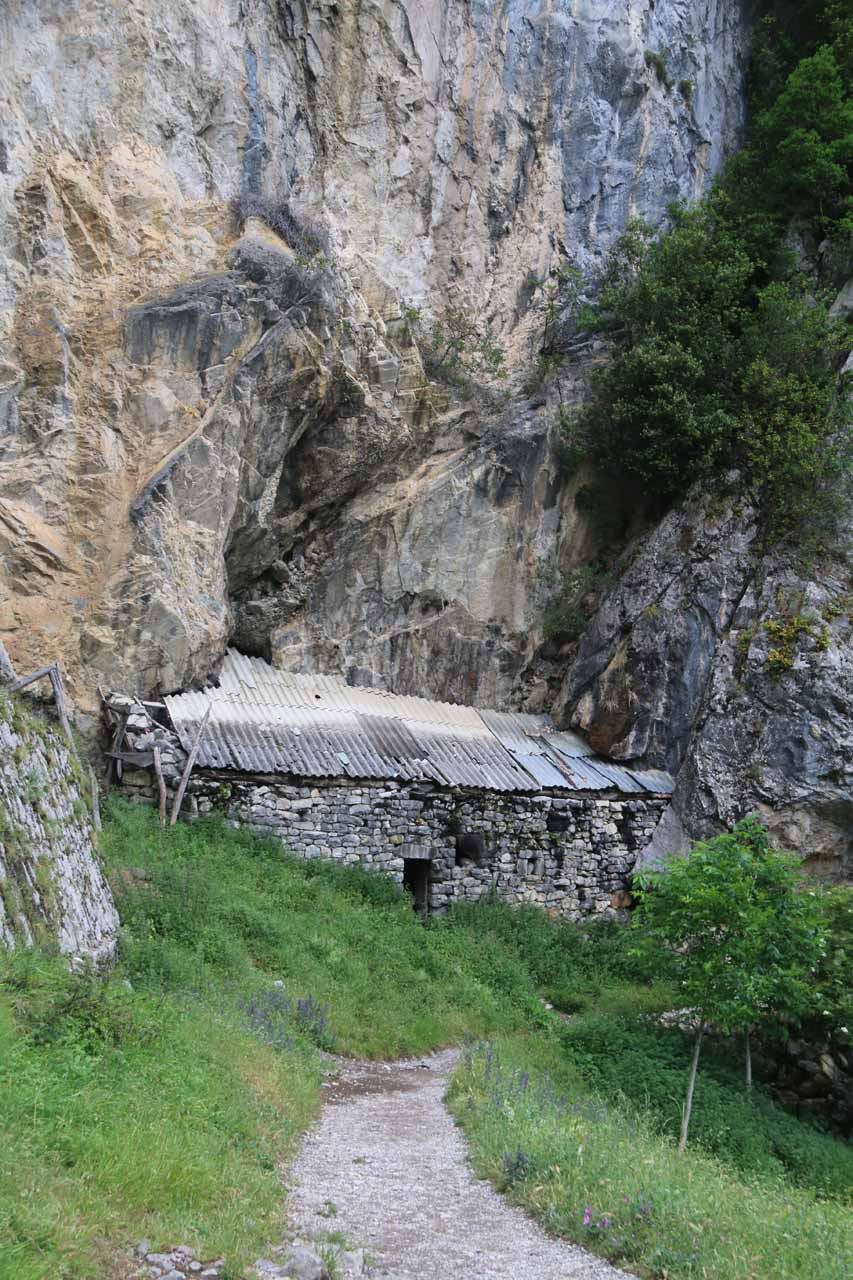 An intriguing shelter built right into the vertical cliffs of the Cares Gorge