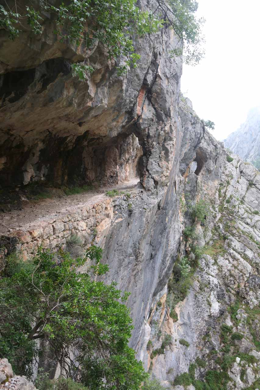 Another cliff-hugging overhanging cliff part of the Ruta de Cares near the natural arch