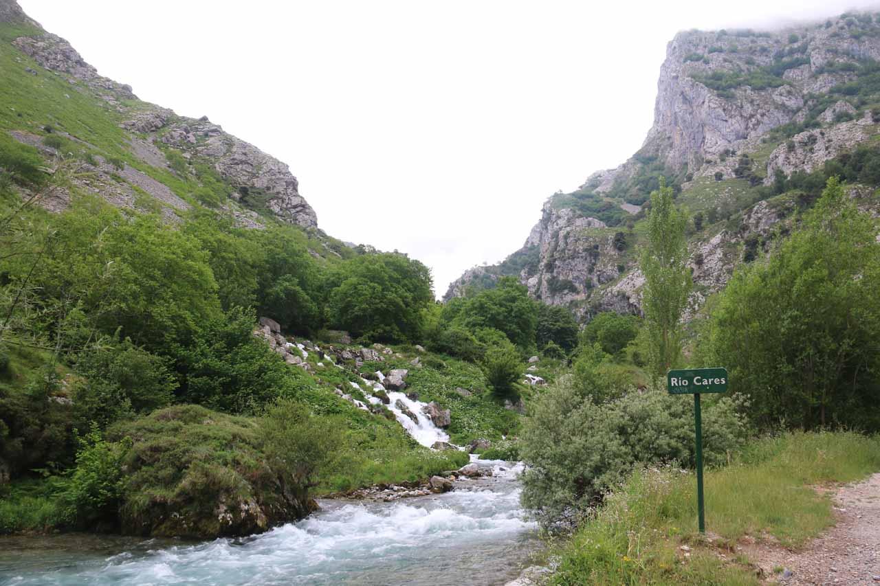 Following the Ruta de Cares along the Rio Cares past this sign and cascade near Cain de Valdeon
