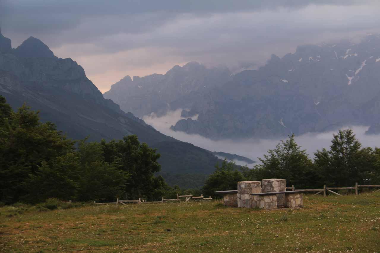 Looking back towards attractive mountains of the Picos de Europa over some picnic area seen in the direction of Posada de Valdeon