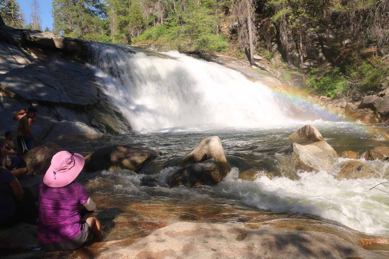 Mom repositioned herself to now get a better look at Carlon Falls while dipping her feet in a pothole