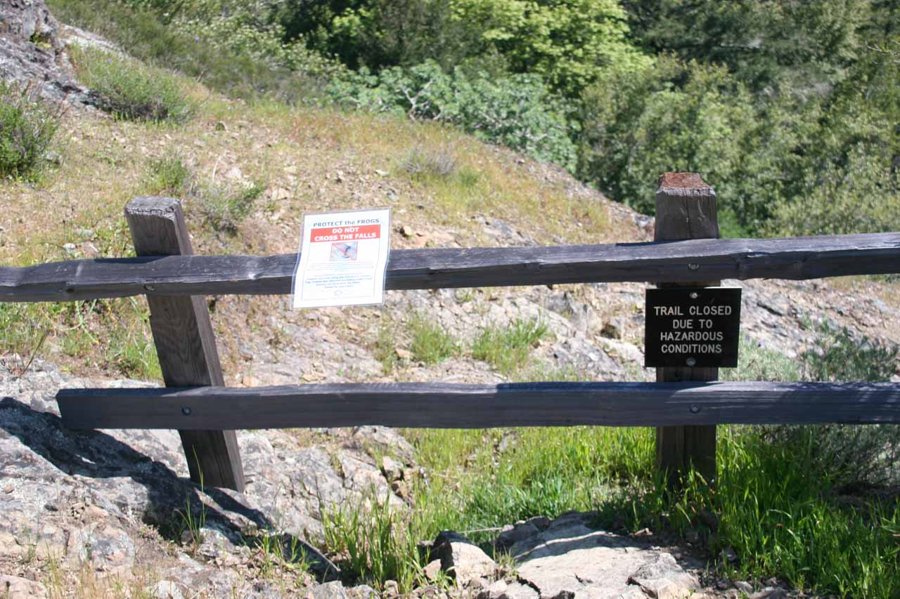 Closure barricades and signs for the old trail