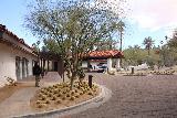 Casa_del_Zorro_001_02092019 - Julie walking towards the main entrance of the Casa del Zorro in Borrego Springs