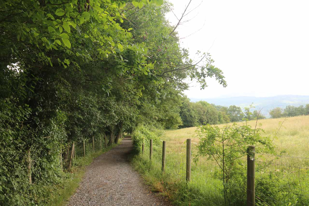 The trail continued to be tree-lined on one side while there were open pastures on the other
