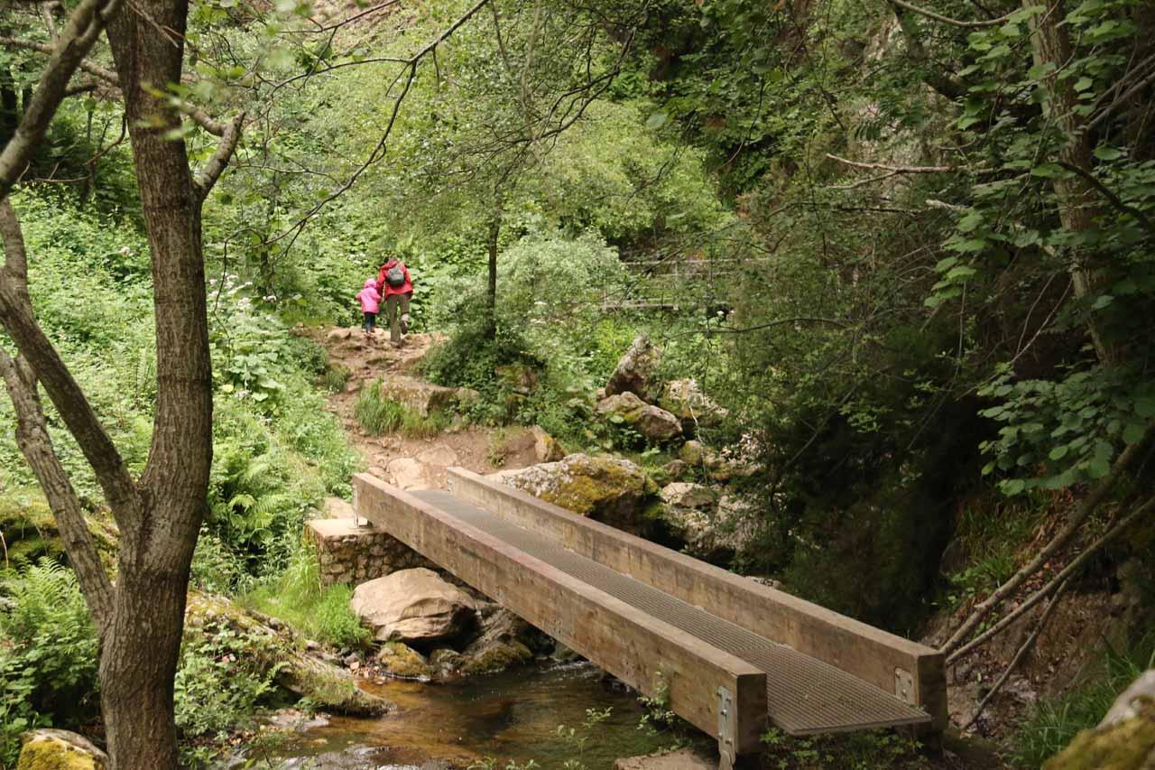 Julie and Tahia crossing over a bridge leading to the Cascada de Nocedo