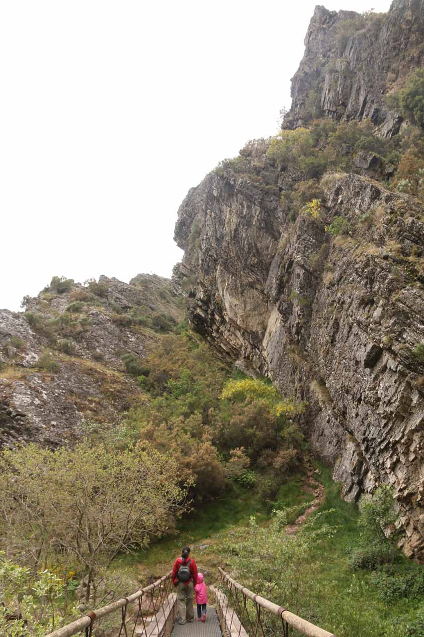 Julie and Tahia towered over by impressive cliffs as we were returning to the car park for Cascada de Nocedo