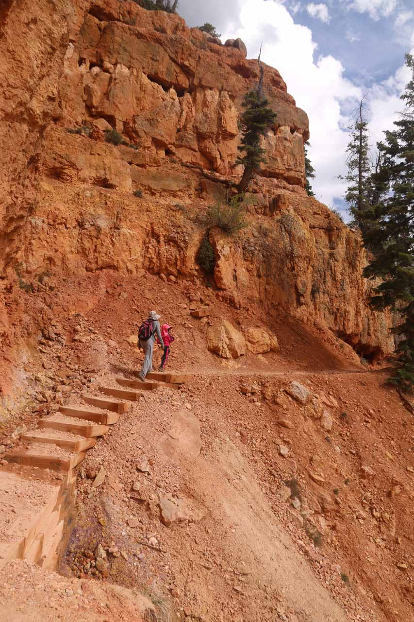 Tahia and Julie going back across the red cliffs on the return hike