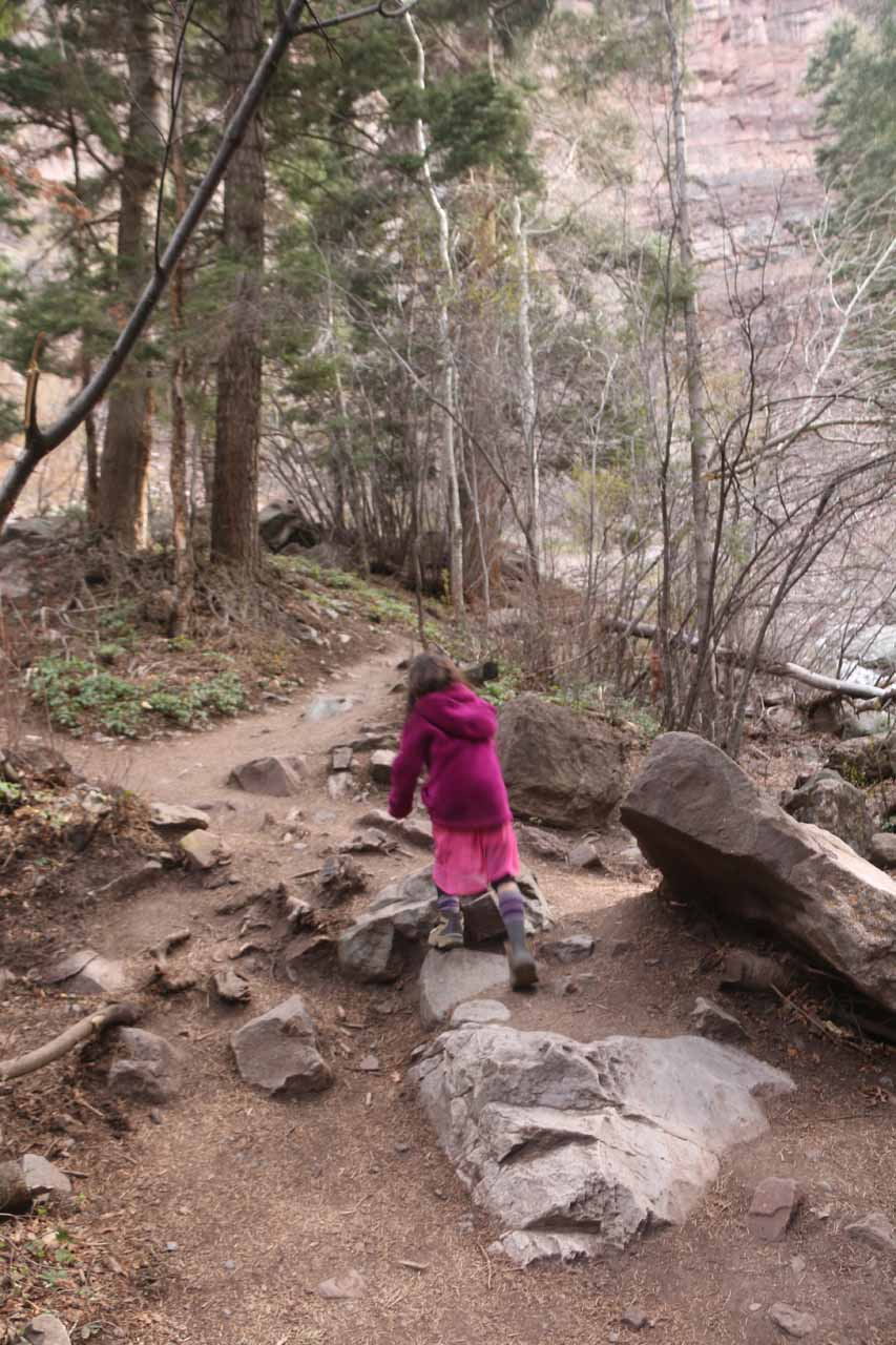 Tahia continuing on the trail leading right up to the base of Cascade Falls