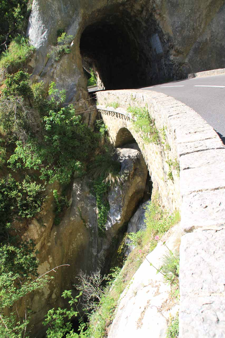 Looking down towards a lower tier of the waterfall beneath the road