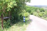 Cascade_de_Tao_017_11252015 - The sign fronting the bridge with the view of Cascade de Tao