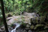 Cascade_de_Tao_047_11252015 - Julie at a stream crossing with rope assist on the way up to the Cascade de Tao