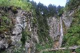 Cascata_di_Tervela_065_07162018 - Looking back towards the Cascata Tervela with a climber statue hanging onto a rock wall above the trail