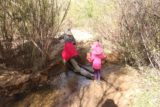 Cedar_Creek_Falls_165_01072017 - Julie and Tahia going across yet another crossing of Cedar Creek on our return hike in January 2017