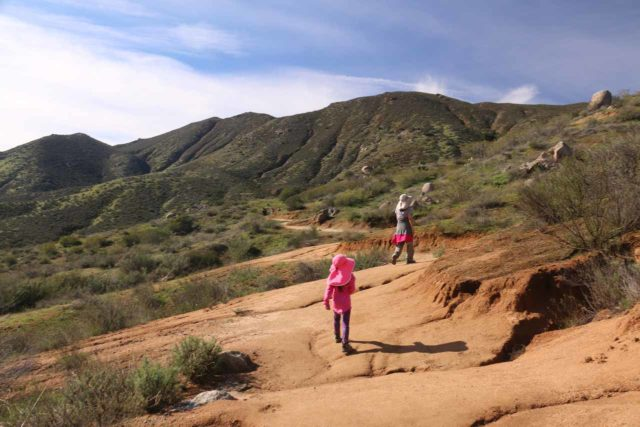 Cedar_Creek_Falls_174_01072017 - Julie and Tahia hiking uphill in the sun back to the Ramona Estates after having had their fill of the Cedar Creek Falls
