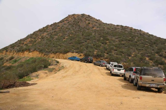 Cedar_Creek_Falls_305_01232016 - Looking back at the unpaved Eagle Peak Road with some cars parked on the shoulder when there's no more parking spaces closer to the locked gates