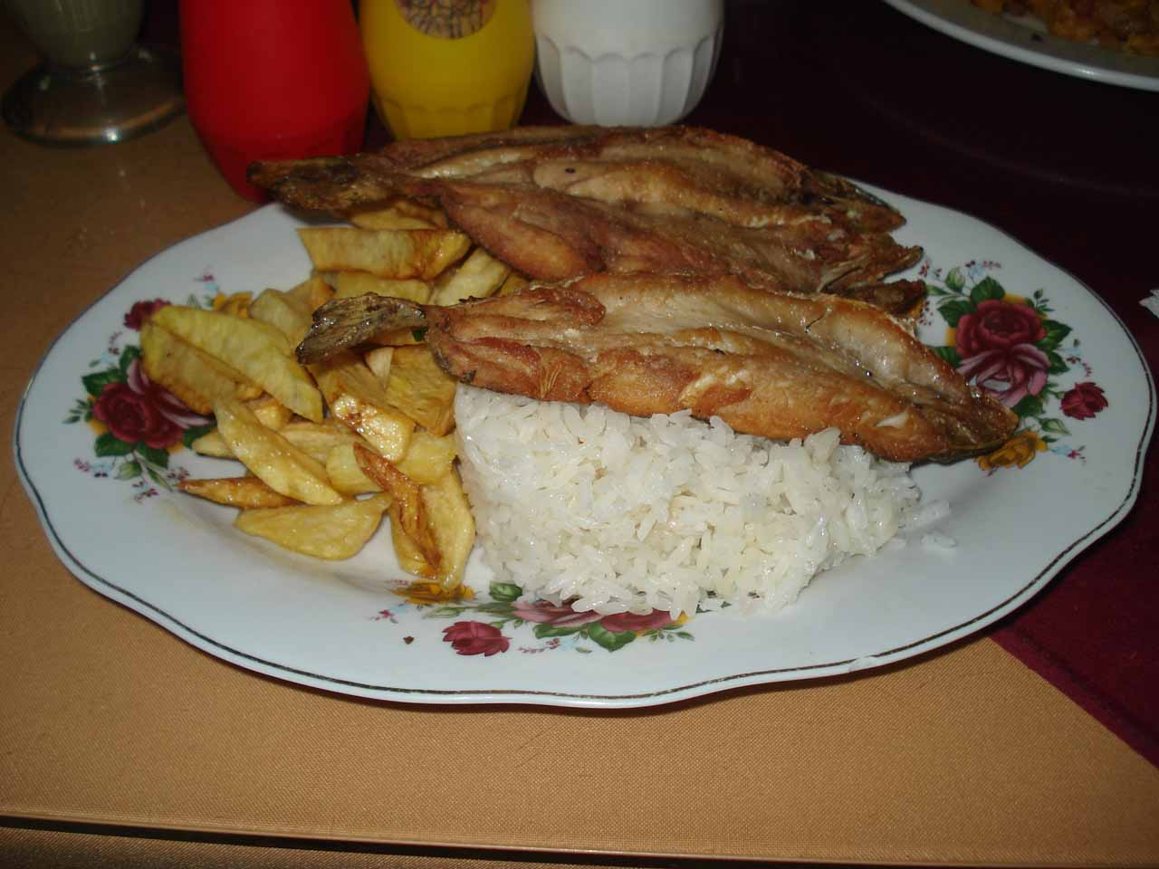 The truchas fritas (fried trout) with papas fritas (fries)
