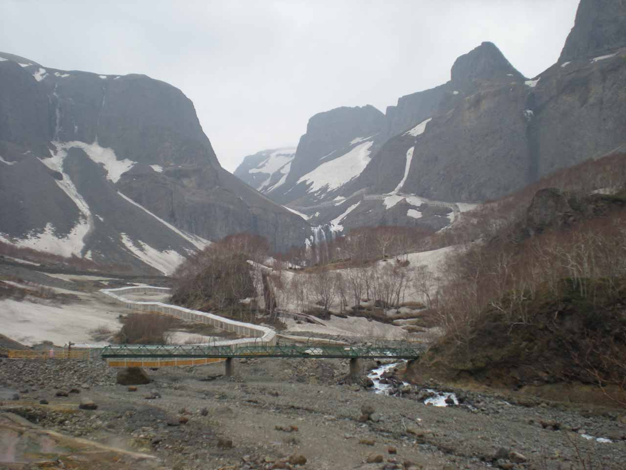 At the trailhead to Changbai Waterfall with the falls in the distance