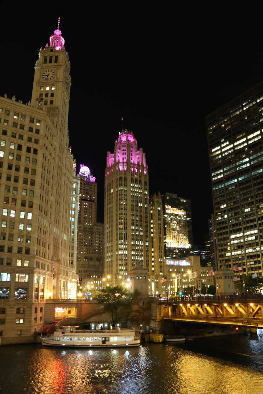 Night time view of the iconic Chicago Tribune building over the Chicago River