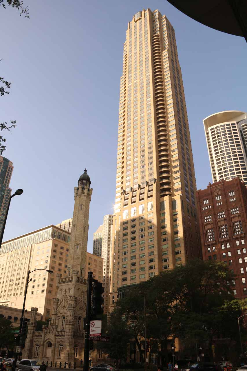 Looking across Michigan Ave at one of the Chicago Water Works buildings dwarfed by a really tall skyscraper