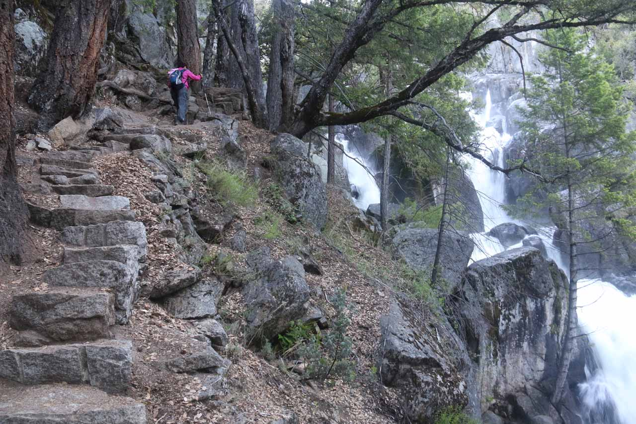 Mom continuing up the narrow granite steps climbing alongside the first Chilnualna Falls