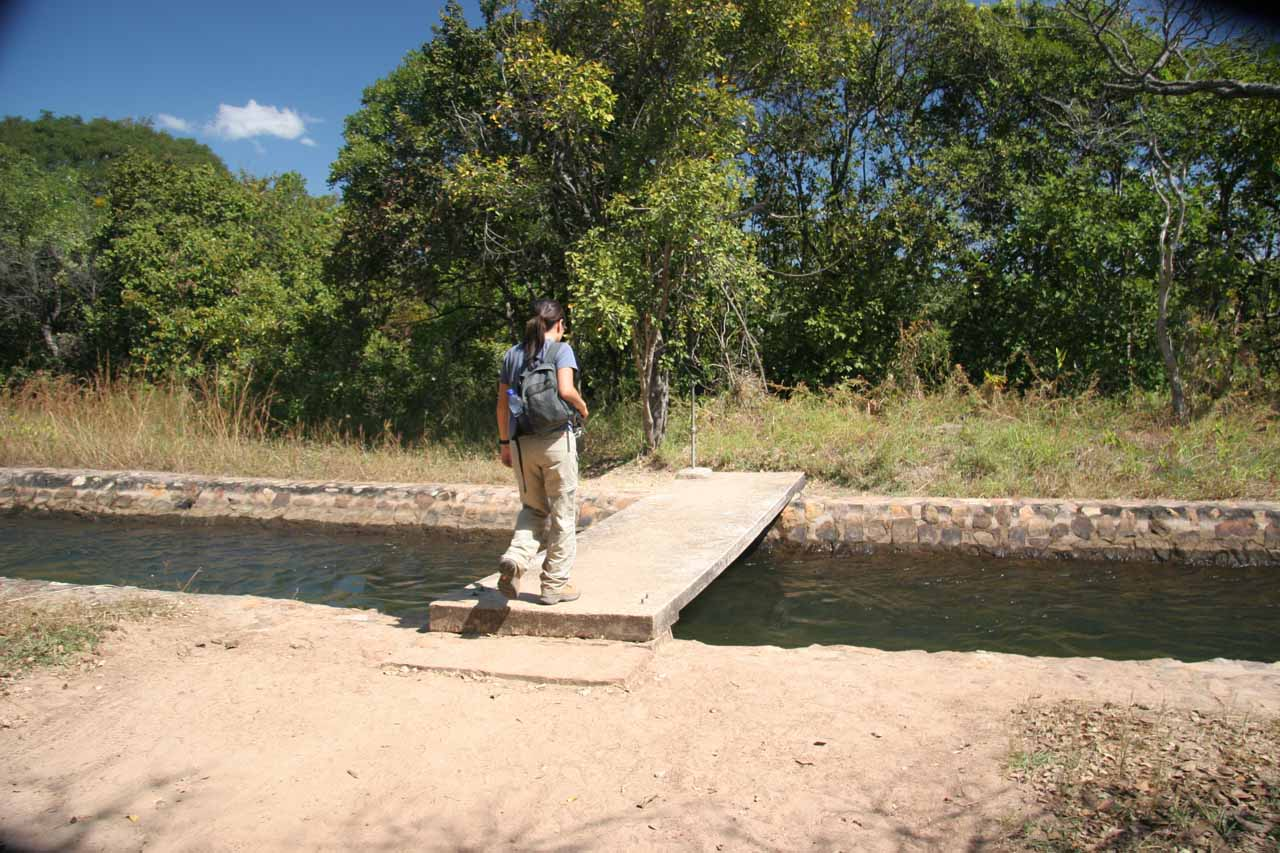 Julie crossing over a diversion channel