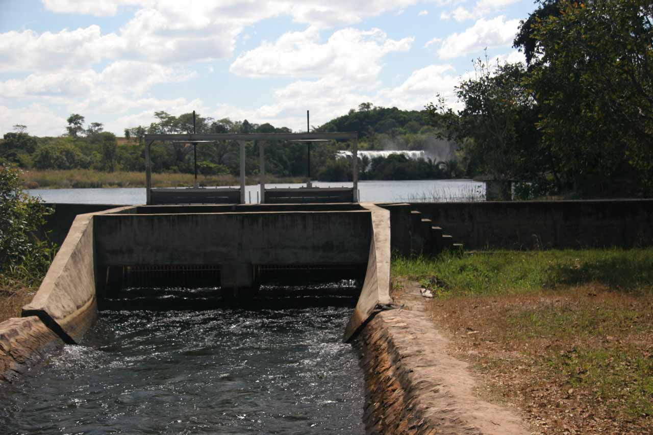 Looking upstream past some flood control and hydro infrastructure towards Mutumuna Falls