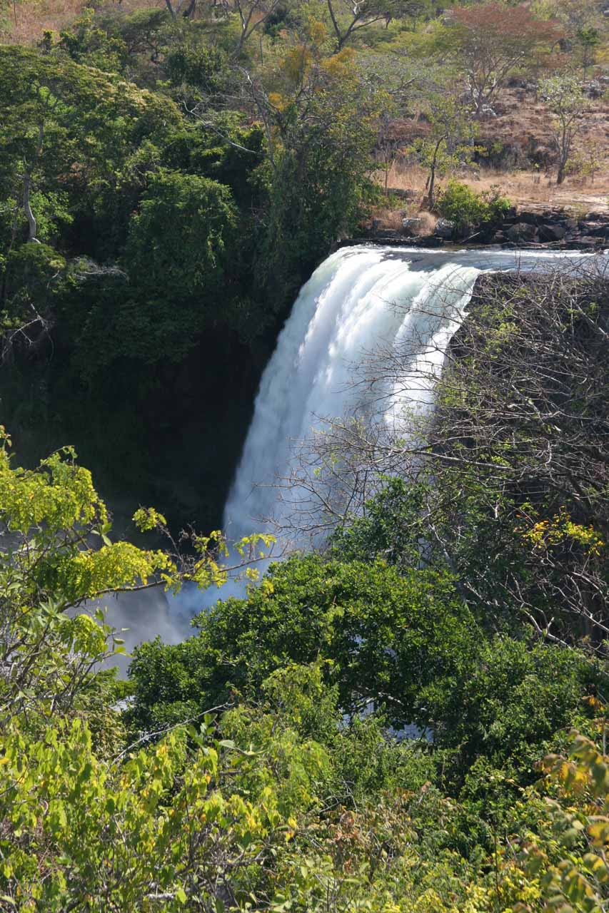 Distant angled view of the main Chishimba Falls from the main trail