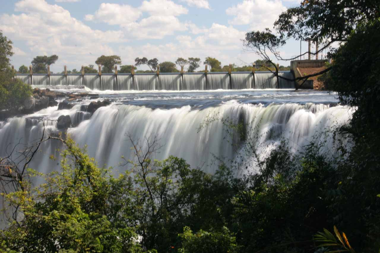 The upper Chishimba Falls (Mutumuna Falls) with some hydroelectric infrastructure further upstream from it