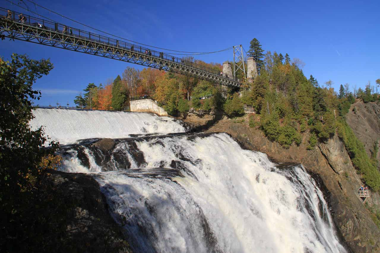 Looking up across the brink of Chute Montmorency towards the suspension bridge spanning the river