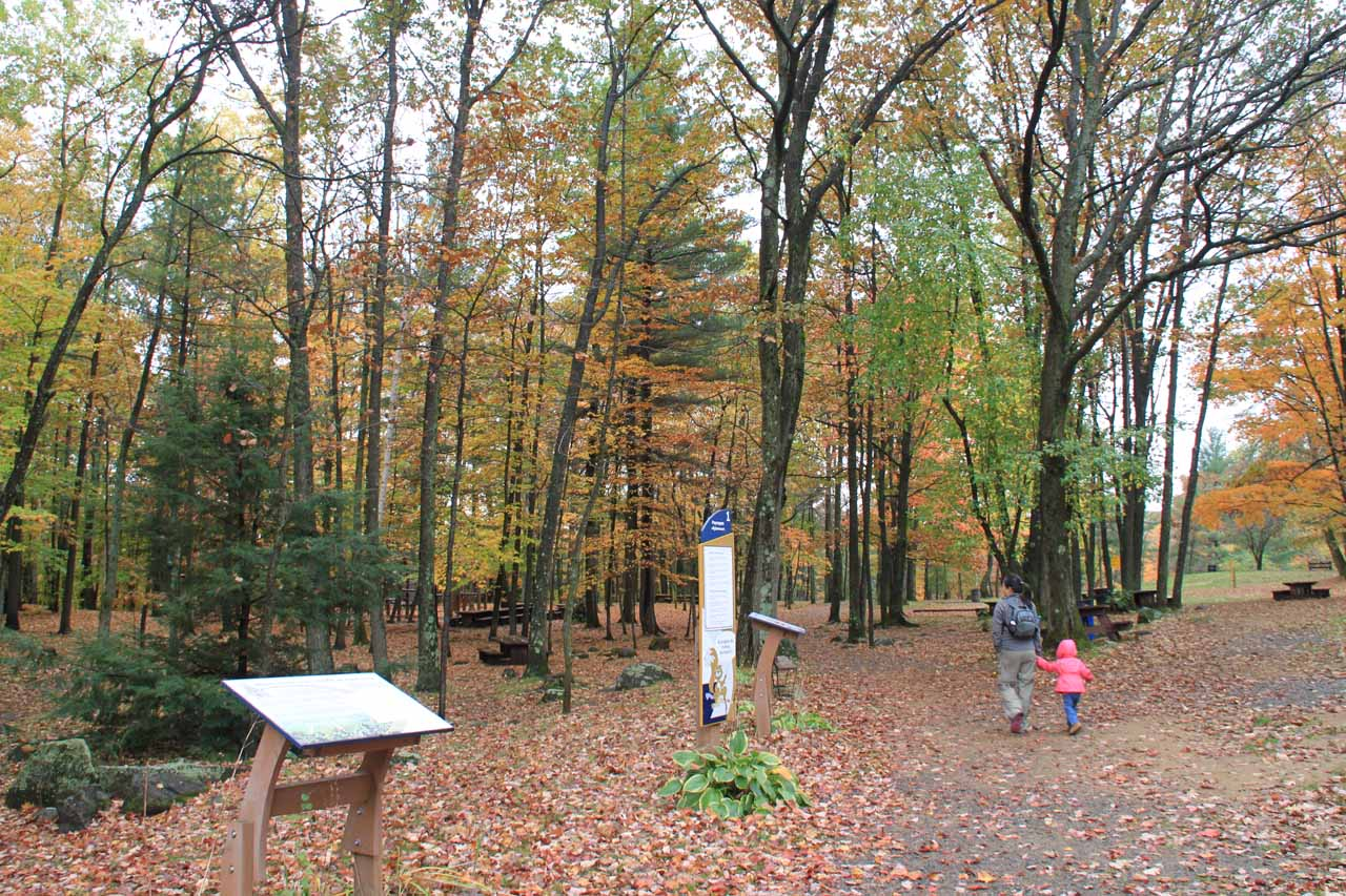 Julie and Tahia walking through the picnic area and playground just past the visitor center