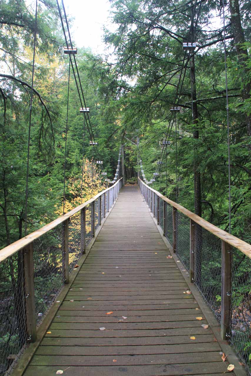 While Julie and Tahia returned to the playground near the visitor center, I kept going down the trail where I encountered this suspension bridge connecting to the lower end of the L'ile de la Chute