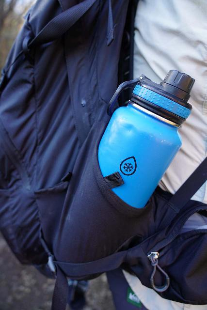 On-the-go hydration (shown here is a tall water bottle using a secondary opening in the side pocket) is one of the key features of the Osprey Manta 34, which makes it very useful as a day hiking backpack