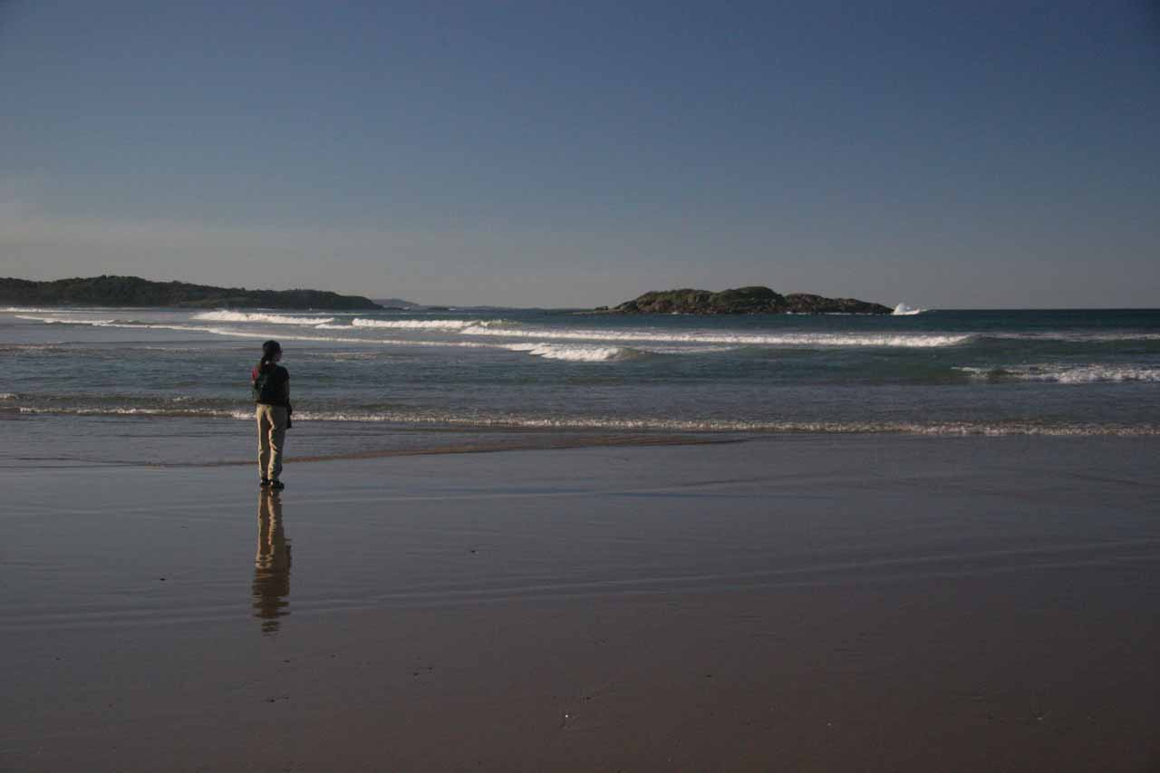 Julie on the wet sands of the beach at Coffs Harbour