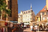 Colmar_271_06202018 - Looking past some tented stalls and cafes towards some other noticeable building in the old town of Colmar