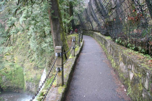 Columbia_River_Gorge_395_03302009 - An overhang with fencing put in place to catch falling rocks that might shed from the vertical cliffs around Multnomah Falls