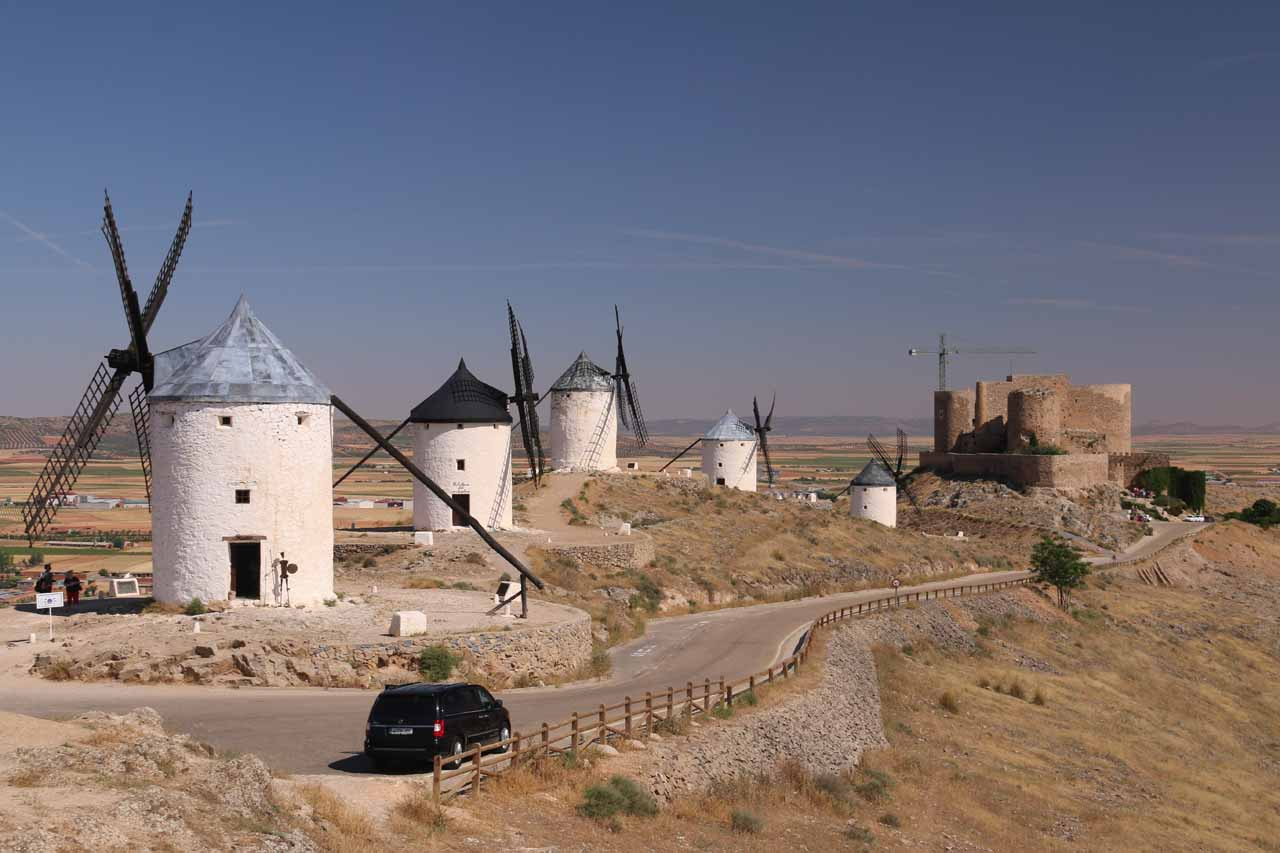 Context of a series of windmills and the castle above Consuegra
