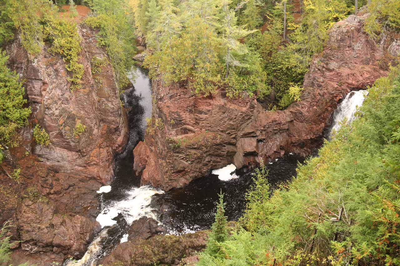 Partial view of Brownstone Falls from the side of the Copper River with the bridge looking down at Copper Falls